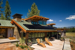 modern sloped roofed house sporting SunPower solar panels along most of the structure