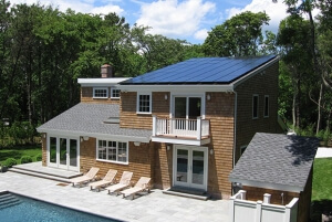 Solar panels covering most of the roof on a large house